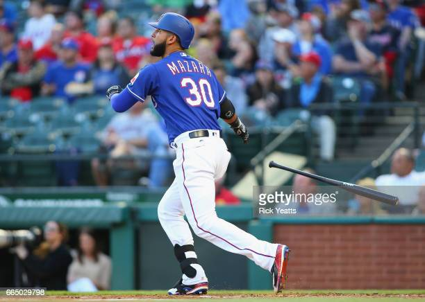 Nomar Mazara of the Texas Rangers hits two run home run in the first inning against the Cleveland Indians at Globe Life Park in Arlington on April 5...