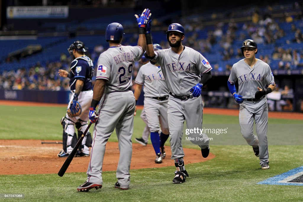 Nomar Mazara #30 of the Texas Rangers is congratulated by Adrian Beltre #29 after hitting a three run home run in the eighth inning during a game against the Tampa Bay Rays at Tropicana Field on April 16, 2018 in St Petersburg, Florida.