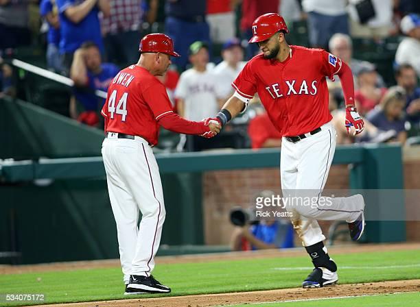 Nomar Mazara of the Texas Rangers is congratulated by interim third base coach Spike Owen on Mazara's tworun home run in the sixth inning against the...