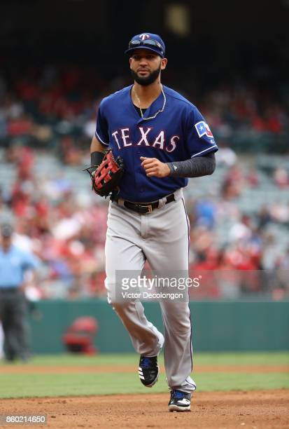 Nomar Mazara of the Texas Rangers jogs back to the dugout after the fourth inning during the MLB game against the Los Angeles Angels of Anaheim at...