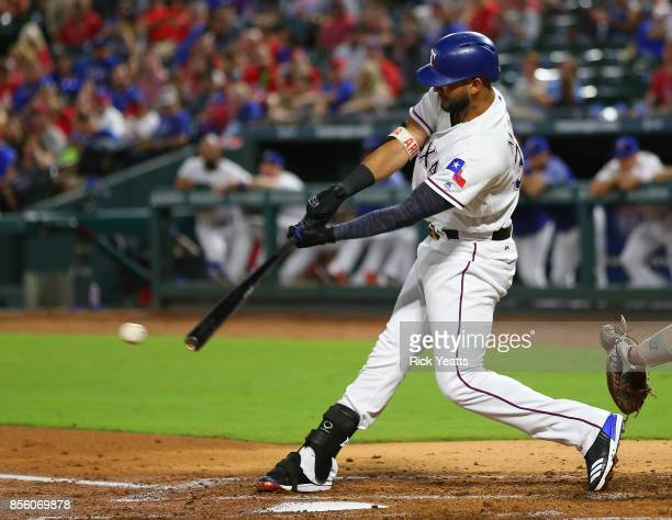 Nomar Mazara of the Texas Rangers makes a base hit in the second inning against the Oakland Athletics at Globe Life Park in Arlington on September 30...