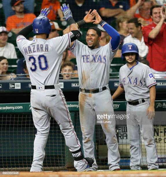 Nomar Mazara of the Texas Rangers receives congratulations from Elvis Andrus after hitting a threerun home run in the eighth inning against the...
