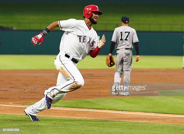 Nomar Mazara of the Texas Rangers rounds third base too score in the first inning on a RBI single hit by Prince Fielder at Global Life Park in...