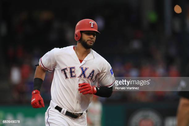 Nomar Mazara of the Texas Rangers runs the bases after hitting a home run against the Philadelphia Phillies in the first inning at Globe Life Park in...