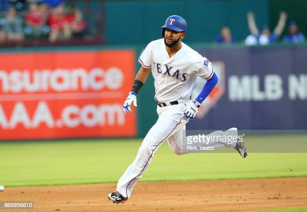 Nomar Mazara of the Texas Rangers runs the bases to score on on Rougned Odor two run home run in the first inning against the Oakland Athletics at...