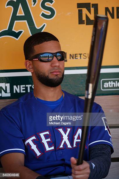Nomar Mazara of the Texas Rangers sits in the dugout during the game against the Oakland Athletics at the Oakland Coliseum on May 18 2016 in Oakland...