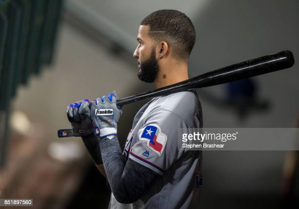 Nomar Mazara of the Texas Rangers stands in the dugout with a bat in hand during a game against the Seattle Mariners at Safeco Field on September 19...
