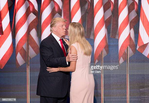 GOP nominee Donald Trump kisses his daughter Ivanka Trump after she introduced him for his acceptance speech at the 2016 Republican National...