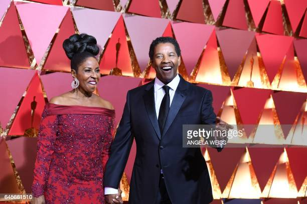 Nominee for Best Actor Fences Denzel Washington arrives on the red carpet with his wife Pauletta for the 89th Oscars on February 26 2017 in Hollywood...
