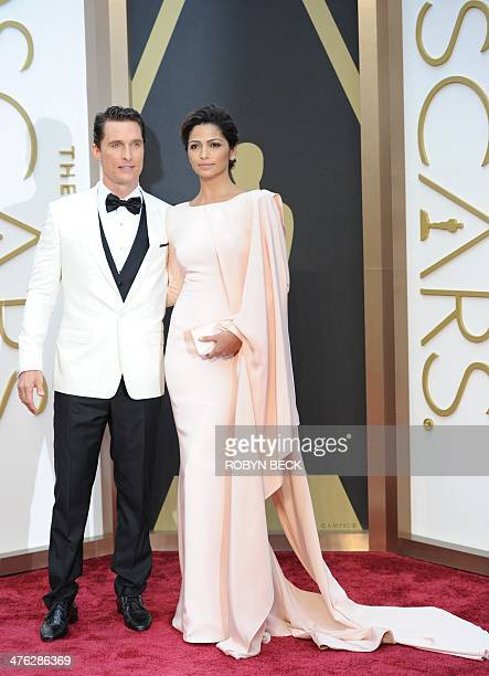 Nominee for Best Actor in Dallas Buyers Club Matthew McConaughey and wife Camila Alves arrives on the red carpet for the 86th Academy Awards on March...