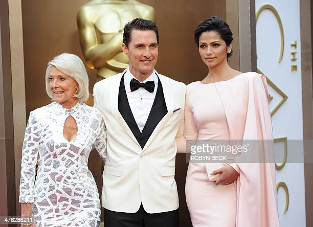 Nominee for Best Actor in Dallas Buyers Club Matthew McConaughey with mother Mary Kathlene and wife Camila Alves arrives on the red carpet for the...