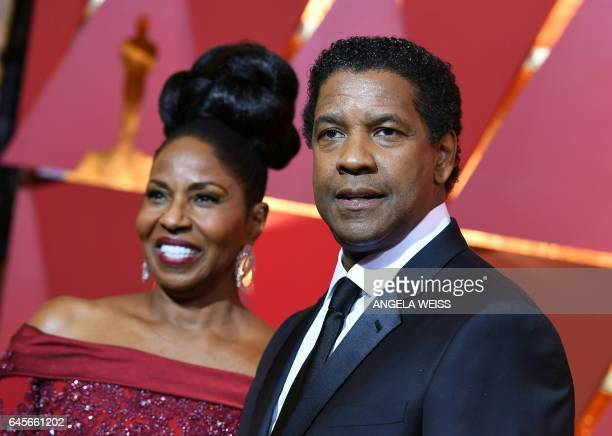 Nominee for Best Actor in Fences Denzel Washington and his wife Pauletta pose as they arrive on the red carpet for the 89th Oscars on February 26...