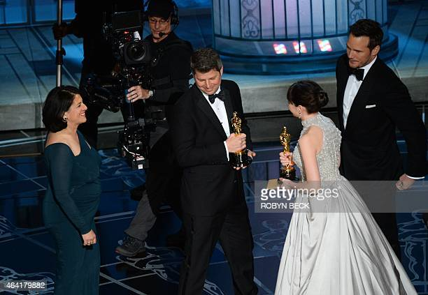 Nominee for Best Actress Felicity Jones and actor Chris Pratt present the award to the winners for Best Production Design The Grand Budapest Hotel...