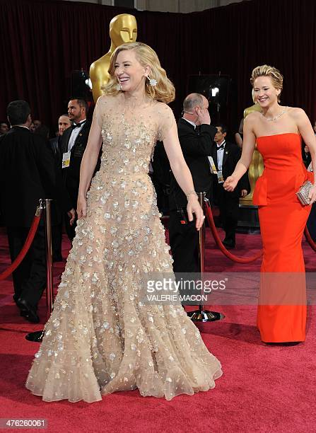Nominee for Best Actress in Blue Jasmine Cate Blanchett and actress Jennifer Lawrence arrive on the red carpet for the 86th Academy Awards on March...