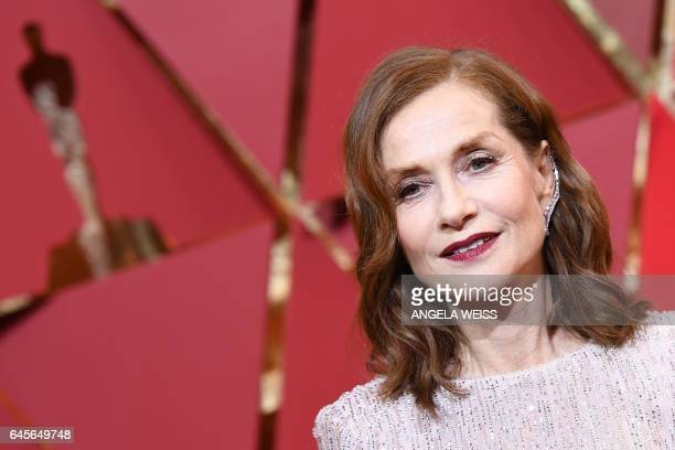 TOPSHOT Nominee for Best Actress in 'Elle' Isabelle Huppert poses as she arrives on the red carpet for the 89th Oscars on February 26 2017 in...
