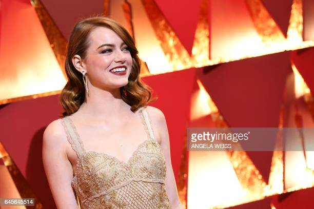 Nominee for Best Actress in 'La La Land' Emma Stone poses as she arrives on the red carpet for the 89th Oscars on February 26 2017 in Hollywood...
