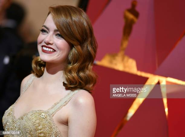 TOPSHOT Nominee for Best Actress 'La La Land' Emma Stone arrives on the red carpet for the 89th Oscars on February 26 2017 in Hollywood California /...