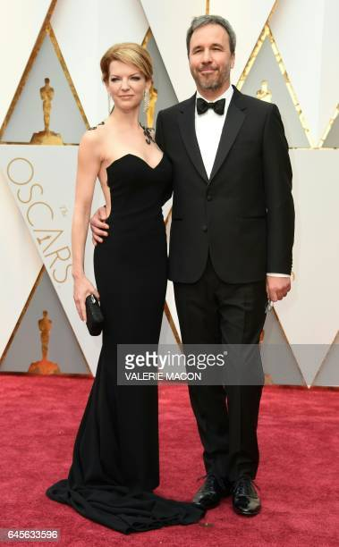 Nominee for Best Director 'Arrival' Denis Villeneuve arrives with a guest on the red carpet for the 89th Oscars on February 26 2017 in Hollywood...