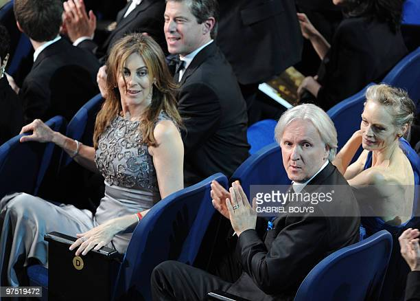 Nominee for Best Director Kathryn Bigelow for 'The Hurt Locker' flanked by exhusband and fellow nominee for Best Director James Cameron for 'Avatar'...