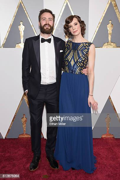 Nominee for Best Live Action Short Film 'Stutterer' Benjamin Cleary and actor Chloe Pirrie wearing a custom dress by Hilfiger Collection attend the...
