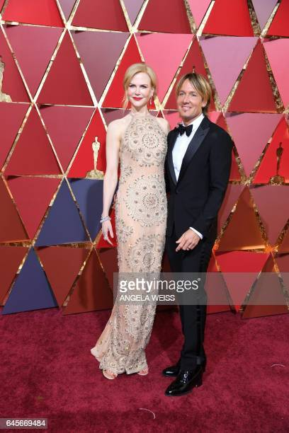 Nominee for Best Supporting Actress 'Lion' Nicole Kidman arrives with her husband Keith Urban on the red carpet for the 89th Oscars on February 26...