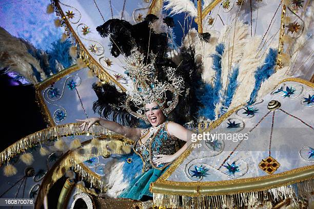 A nominee for Queen of the 2013 Santa Cruz carnival performs in Santa Cruz de Tenerife on the Spanish Canary island of Tenerife on February 6 2013...