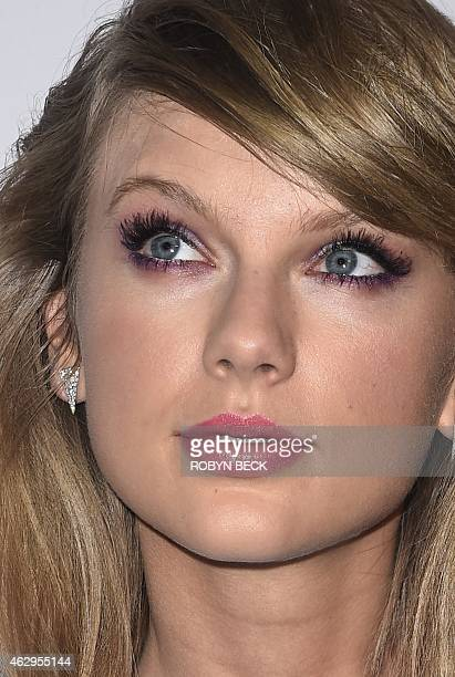 Nominee for Record Of The Year Taylor Swift arrives for the Clive Davis The Recording Academy's 2015 PreGrammy Gala in Beverly Hills California...