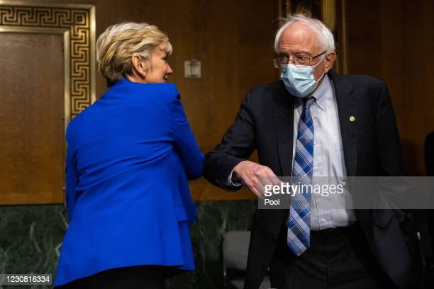 Nominee for Secretary of Energy Jennifer Granholm greets Senator Bernie Sanders prior to her confirmation hearing before the Senate Committee on...