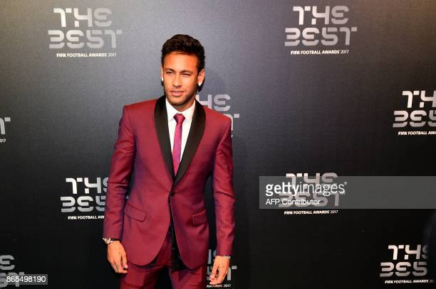 TOPSHOT Nominee for the Best FIFA football player Paris SaintGermain and Brazil forward Neymar poses for a photograph as he arrives for The Best FIFA...