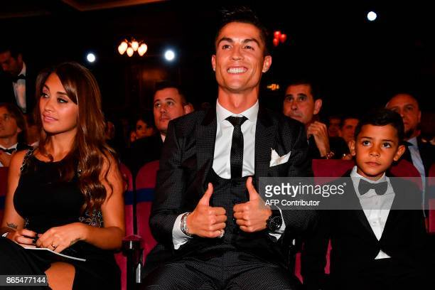 Nominee for the Best FIFA football player Real Madrid and Portugal forward Cristiano Ronaldo gestures next to his son Cristiano Ronaldo Jr and Lionel...