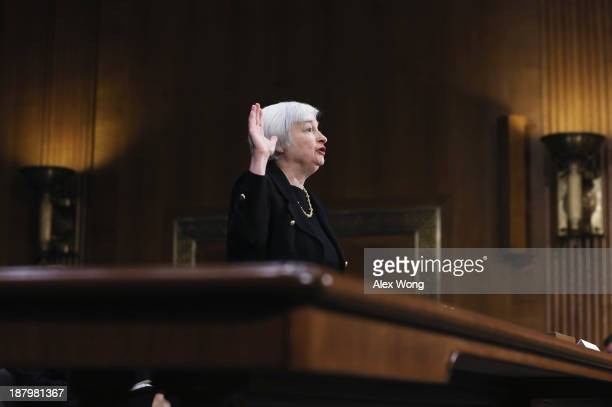 Nominee for the Federal Reserve Board Chairman Janet Yellen is sworn in during her confirmation hearing November 14 2013 on Capitol Hill in...