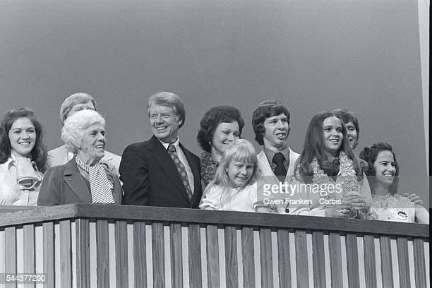 Nominee Jimmy Carter stands at the podium with his family at the 1976 Democratic National Convention