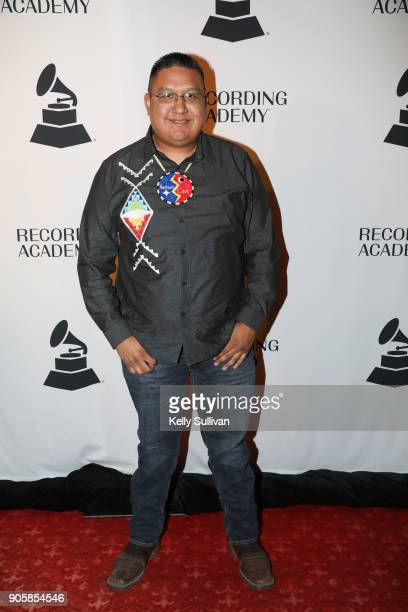 GRAMMY nominee Marlon Deschamps of the band Northern Cree poses for a photo on the red carpet at the San Francisco 60th GRAMMY Award Nominee...