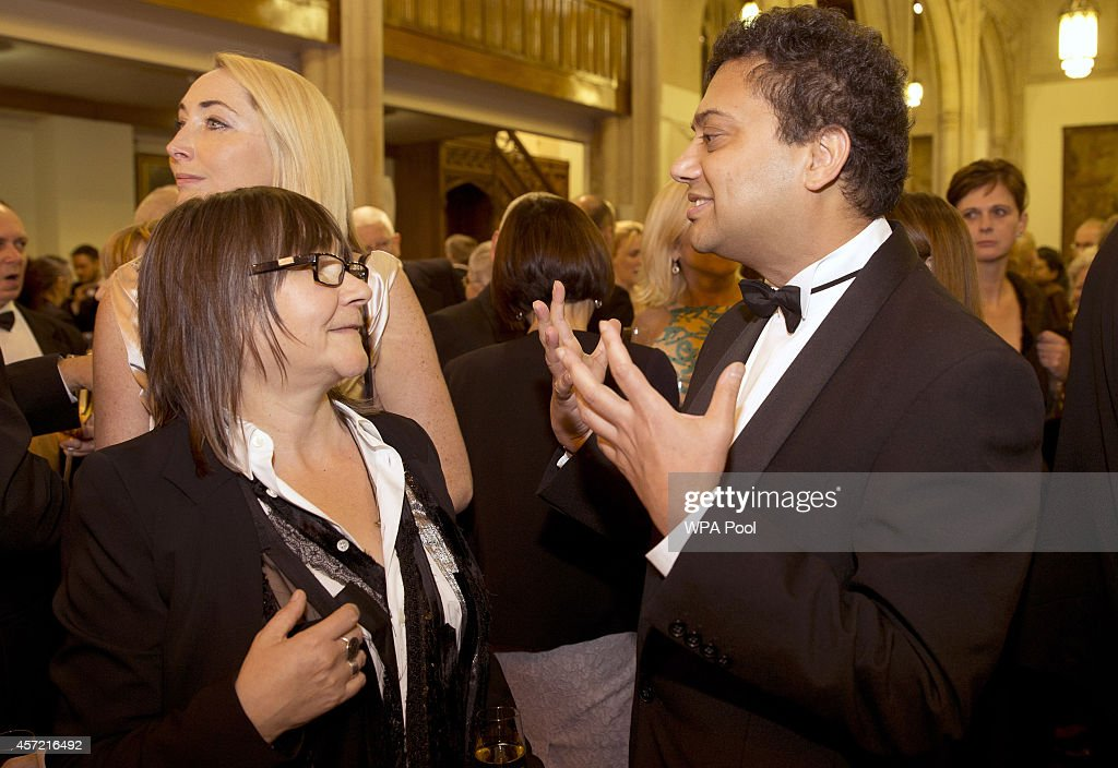 Nominees, British author Ali Smith (L) who wrote' How to be Both', and British author Neel Mukherjee who wrote 'The Lives of Others', talk prior to the awards dinner for the Man Booker for fiction 2014 at the Guildhall on October 14, 2014 in London, United Kingdom.