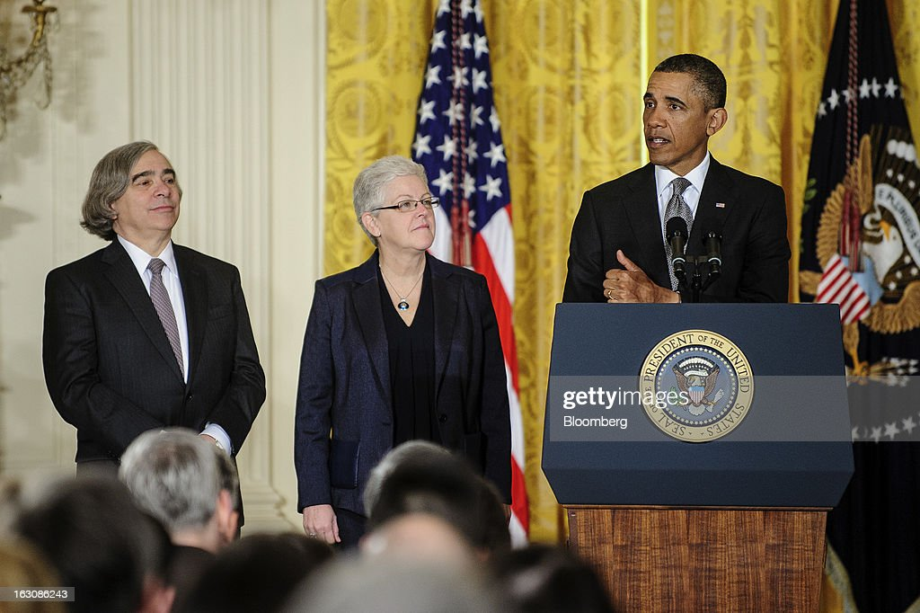 Nominees Ernest Moniz, left, and Gina McCarthy, second from left, listen as U.S. President Barack Obama announces personnel nominations in the East Room of the White House in in Washington, D.C., U.S., on Monday, March 4, 2013. Obama announced three cabinet-level nominations, choosing Sylvia Mathews Burwell of the Wal-Mart Foundation as director of the Office of Management and Budget, scientist Moniz as head of the Energy Department, and McCarthy to lead the Environmental Protection Agency (EPA), where she's been an assistant administrator. Photographer: Pete Marovich/Bloomberg via Getty Images