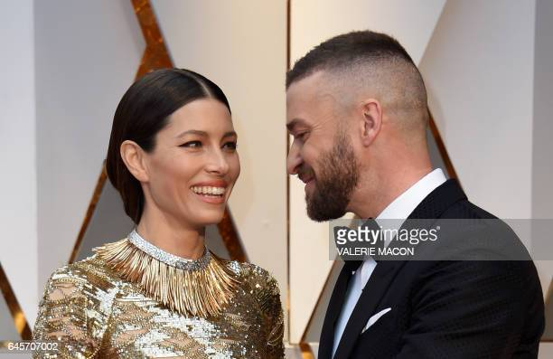 TOPSHOT Nominees for Best Music 'Can't Stop The Feeling' from Trolls Justin Timberlake and his wife US actress Jessica Biel arrive on the red carpet...