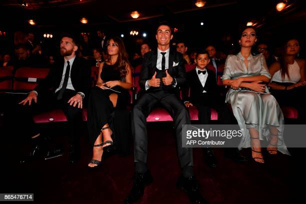 Nominees for the Best FIFA football player Barcelona and Argentina forward Lionel Messi with his wife Antonella Roccuzzo take their seats next to...