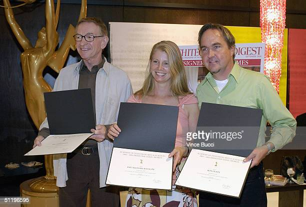 Nominees Roy Christopher Amy SkjonsbyWinslow and Ron Olsen pose at a reception hosted by Architectural Digest and the Academy of Television Arts and...