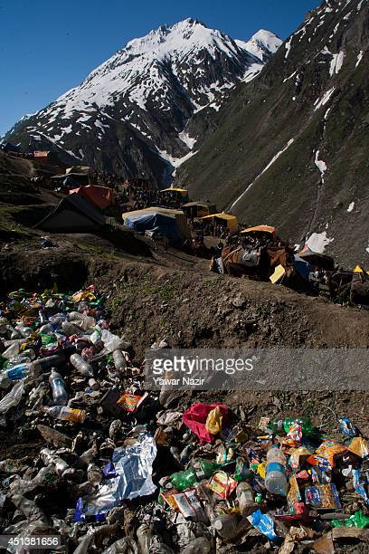 Non bio degradeable waste lies on top of mountain left by Hindu pilgrims in next to their camps during their pilgrimage to the sacred Amarnath Cave...