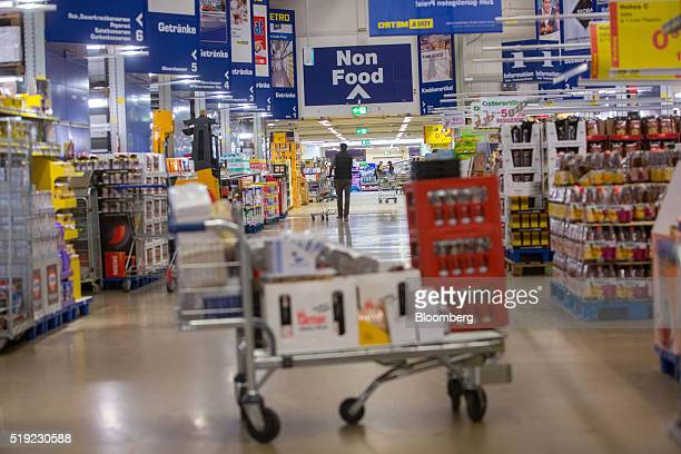 A non food sign hangs above aisles inside a Metro AG Cash Carry wholesale store in Duesseldorf Germany on Tuesday April 5 2016 German retailer Metro...