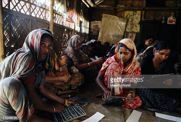 A non formal educational class for women run by CONCERN in Demra Dhaka Bangladesh The adult literacy rate in Bangladesh is about 40% The Non...