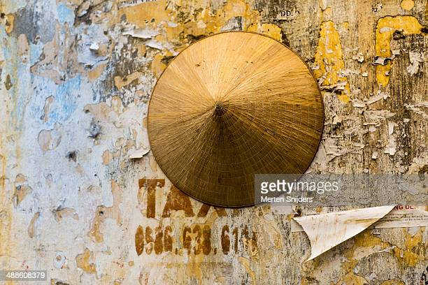 non la leaf hat hanging on deprived wall - merten snijders stock pictures, royalty-free photos & images