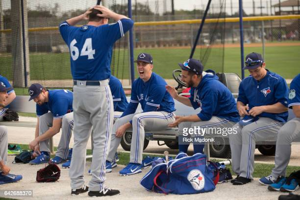 Non roster pitcher Lucas Harrell has Aaron Sanchez and Marco Estrada in a good laugh as he tells a story prior to start of warm up Toronto Blue Jays...