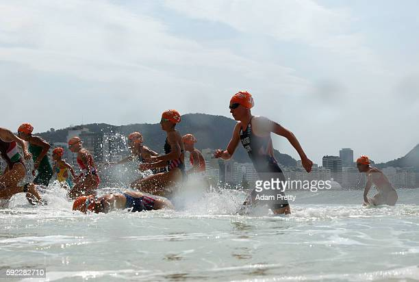 Non Stanford of Great Britain races from the water with fellow athletes during the Women's Triathlon on Day 15 of the Rio 2016 Olympic Games at Fort...