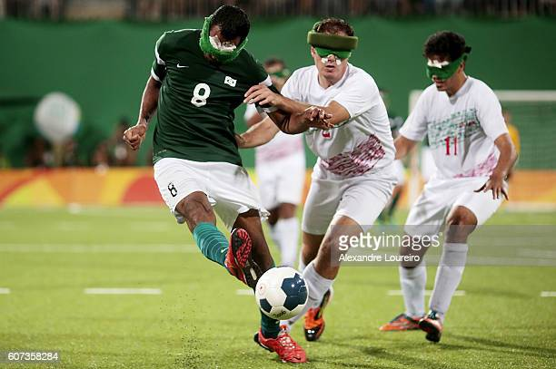 Nonato of Brazil fights for the ball with Amir Pourrazavi of Iran during the Football 5aside Brazil and Iran Gold Medal Match at Olympic Tennis...