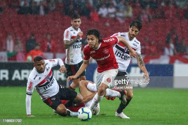 Nonato of Internacional battles for the ball against Reinaldo of Sao Paulo during the match Internacional v Sao Paulo as part of Brasileirao Series A...