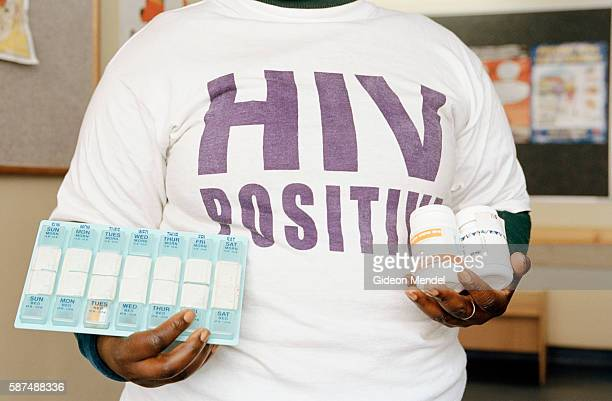 Noncedo Bulana an HIVpositive TAC activist demonstrates the antiretroviral medications she is taking Before receiving ARV therapy her CD4 count was...