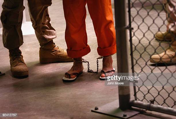 "Non-compliant"" detainee is escorted by guards after showering inside the U.S. Military prison for ""enemy combatants"" on October 27, 2009 in..."