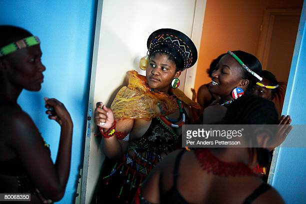 Nondumiso Rakale age 21 chats to her friends as she goes through a coming of age ceremony outside her house on December 16 2006 in Jabulani section...