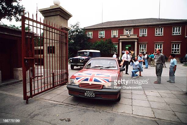 Nonessential British Embassy officials and their families prepare to leave China soon after the Communist Government sent troops to brutally suppress...
